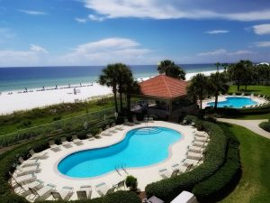 A view of the pool and beach from this beach condo rental