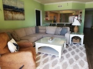 Living room and kitchen in this rental