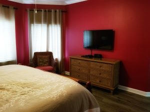 Master bedroom with Tv in this beach rental