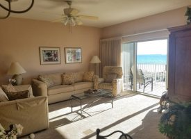 Living room seating in this beach condo rental