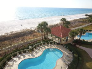 View of the patio, pools, beach and water at our PCB vacation condos