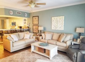 Living room with pale blue and light gray coastal decor
