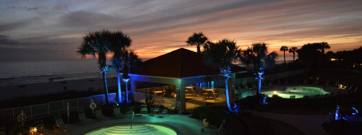 View of the pool and beach at night -- Coral Reef Condos in Panama City Beach, Florida.